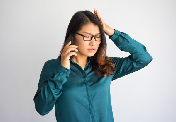 concerned-young-asian-woman-speaking-phone